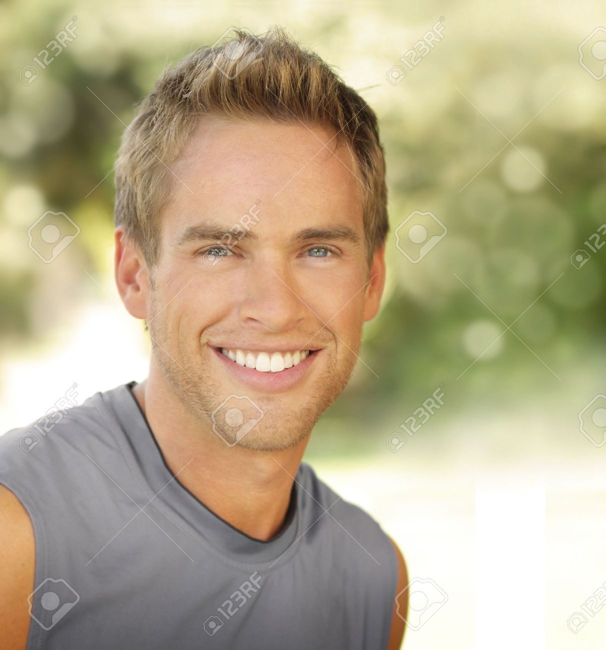 Satisfied smiling young male outdoors with copy space Stock Photo - 16826077