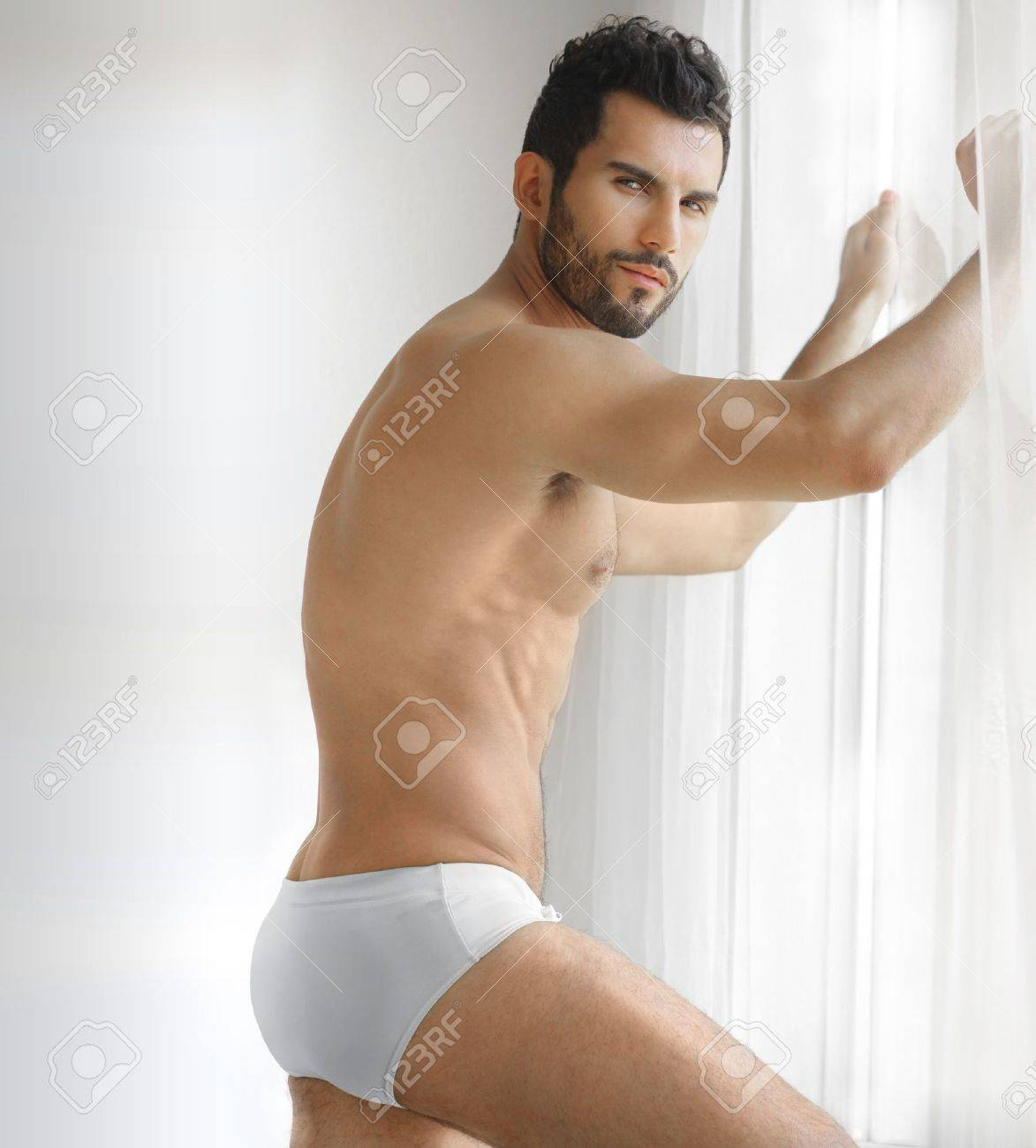 Stock Photo - Very sexy young male muscular model in white underwear in  front of window 4f50a8ff7ee0