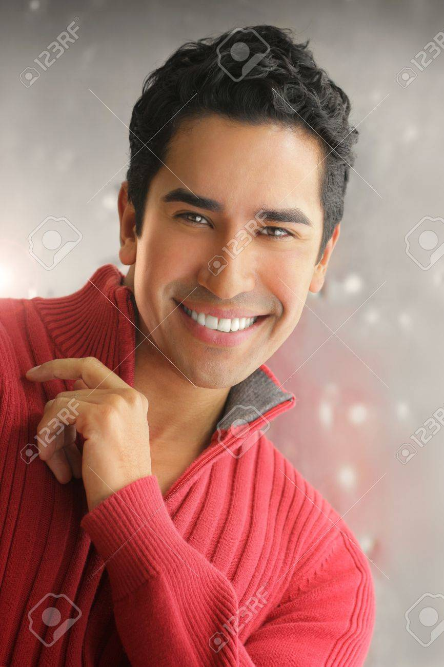 Handsome young man with a charming big smile against modern background Stock Photo - 17751834
