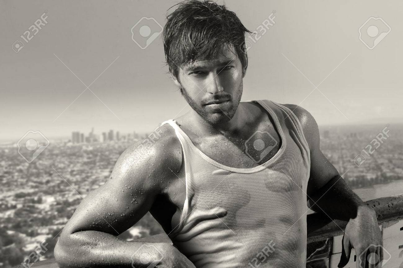 Classic black and white portrait of a young handsome man above city skyline stock photo