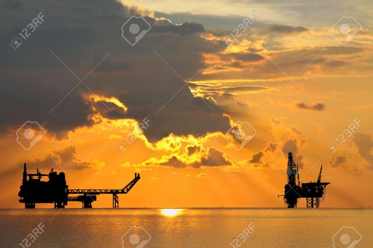 Gas platform and Rig platform in sunset or sunrise time - 21429122