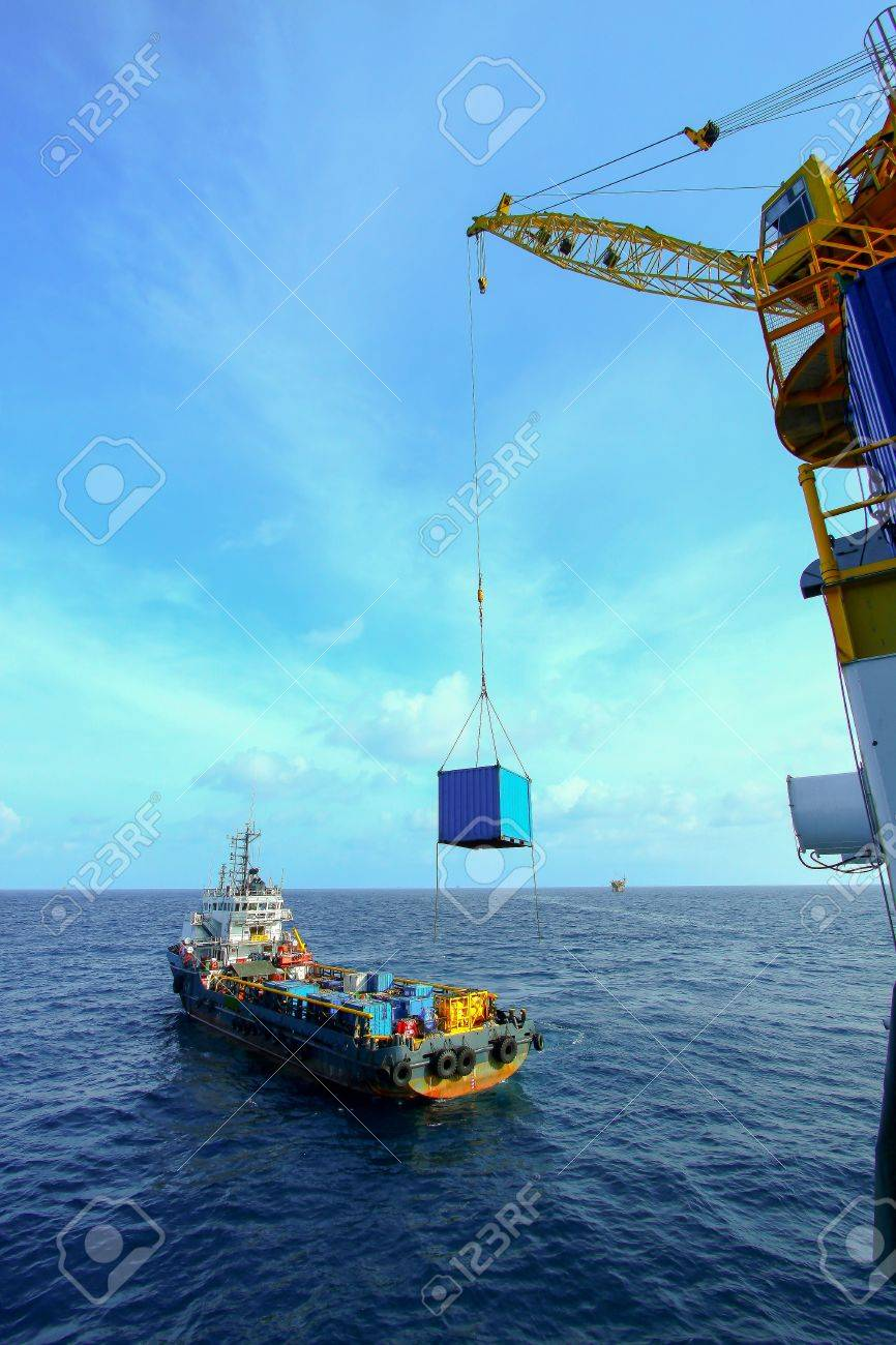 Crane operation with supply boat Stock Photo - 21648385
