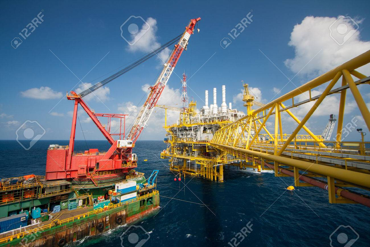 Large crane vessel installing the platform in offshore,crane barge doing marine heavy lift installation works in the gulf or the sea Stock Photo - 25940984