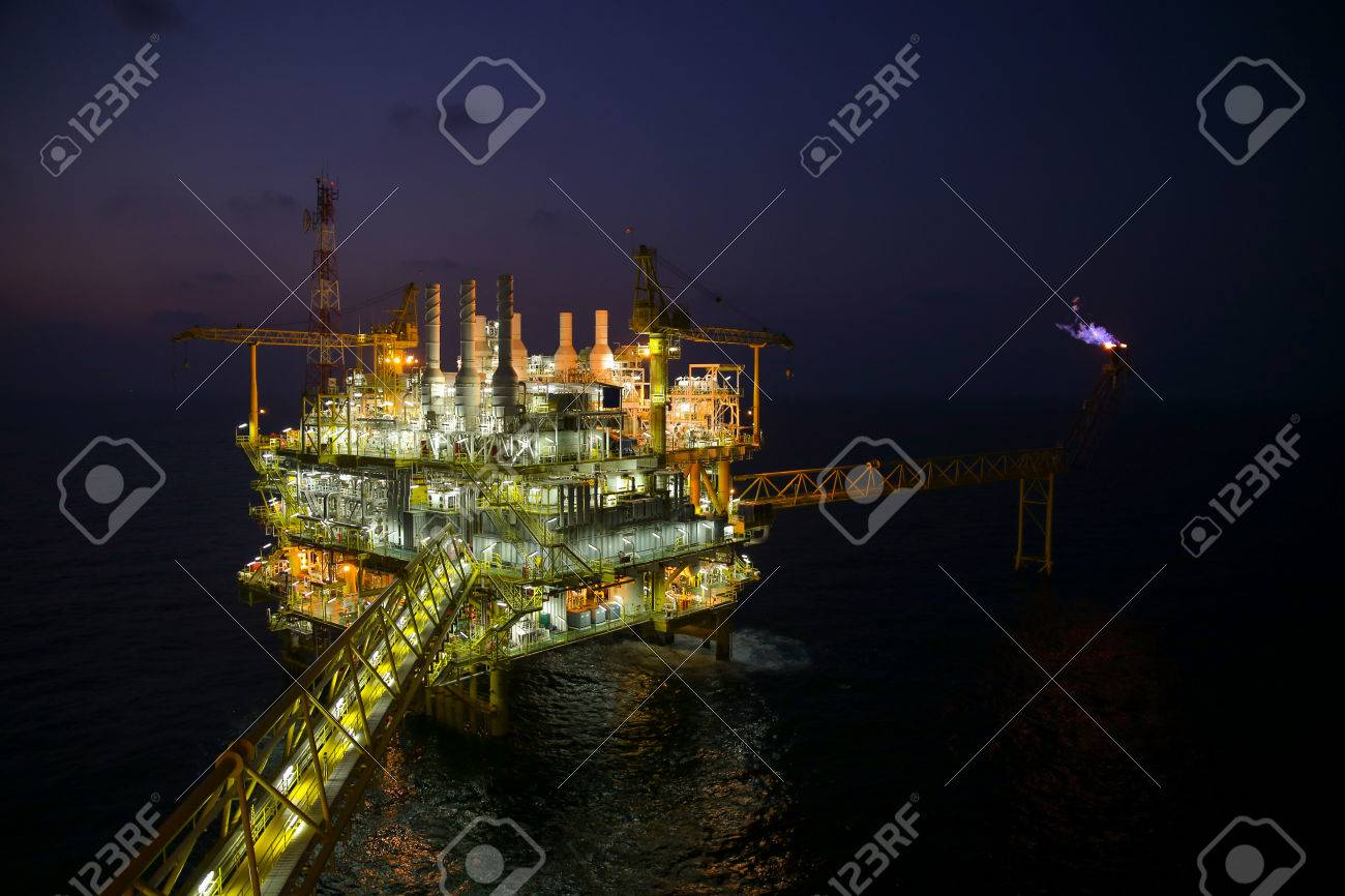 oil and gas construction in night view. View from helicopter night flight. Oil and gas platform in offshore Stock Photo - 36221962