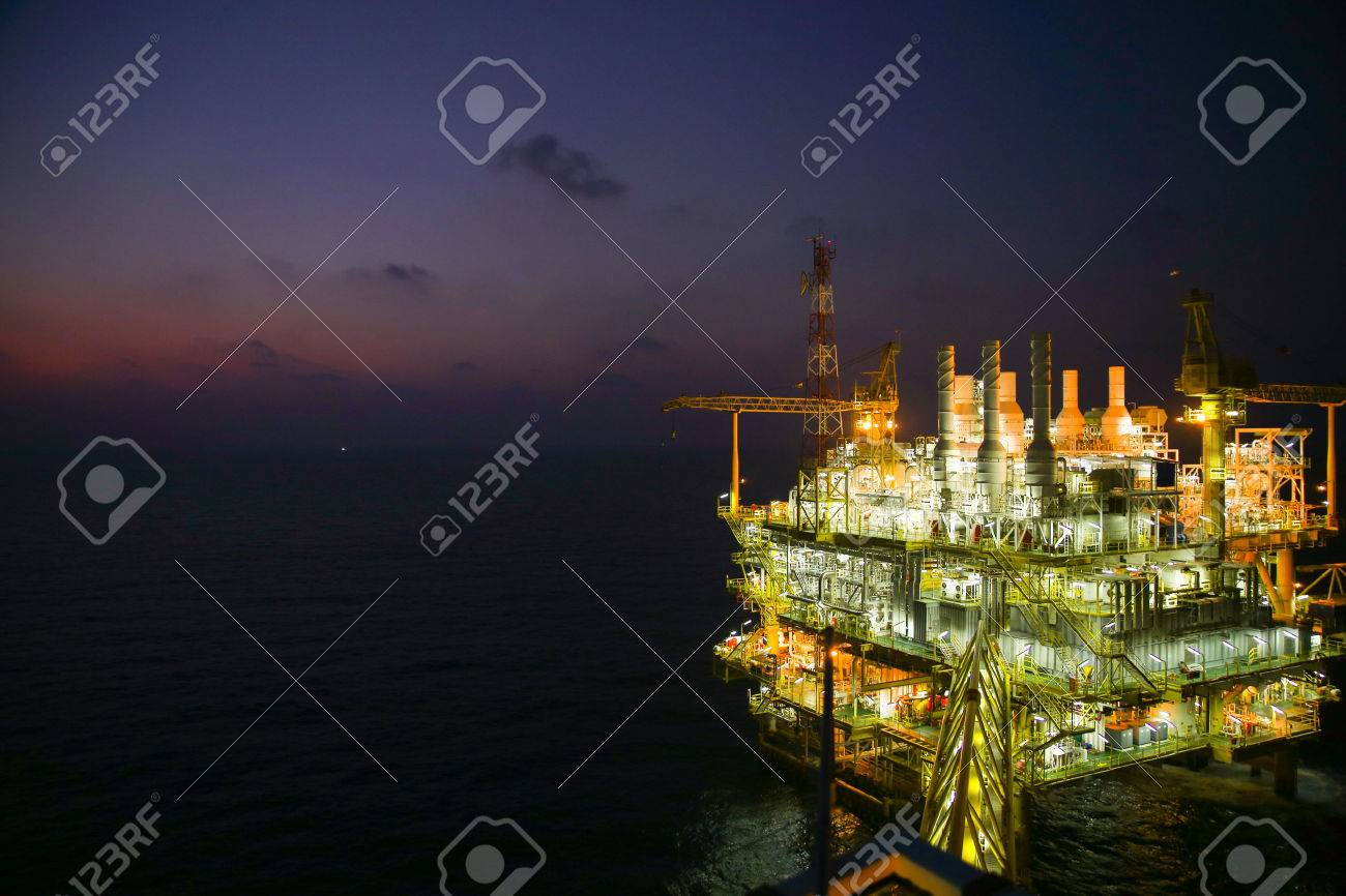 oil and gas construction in night view. View from helicopter night flight. Oil and gas platform in offshore Stock Photo - 36221981