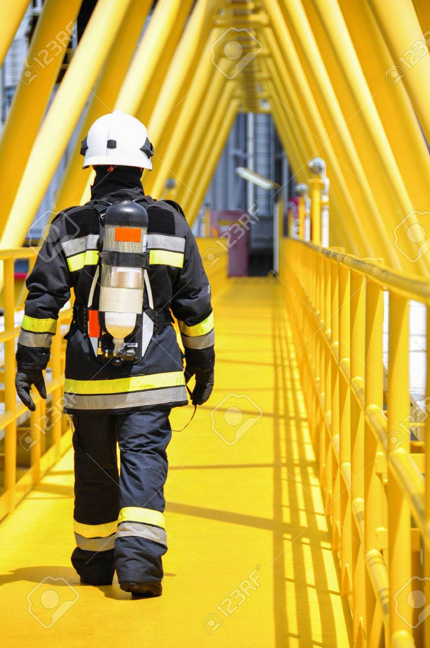 Fire fighter on oil and gas industry, successful firefighter at work Stock Photo - 38181357