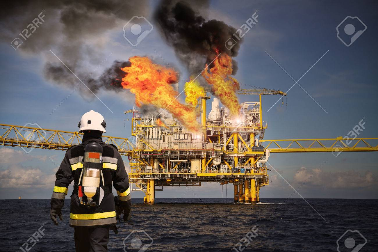Fire fighter on oil and gas industry, successful firefighter at work , Fire suit for fighter with fire and suit for protect fire fighter, Security team when fire case. restricted area or danger area. Stock Photo - 58236197
