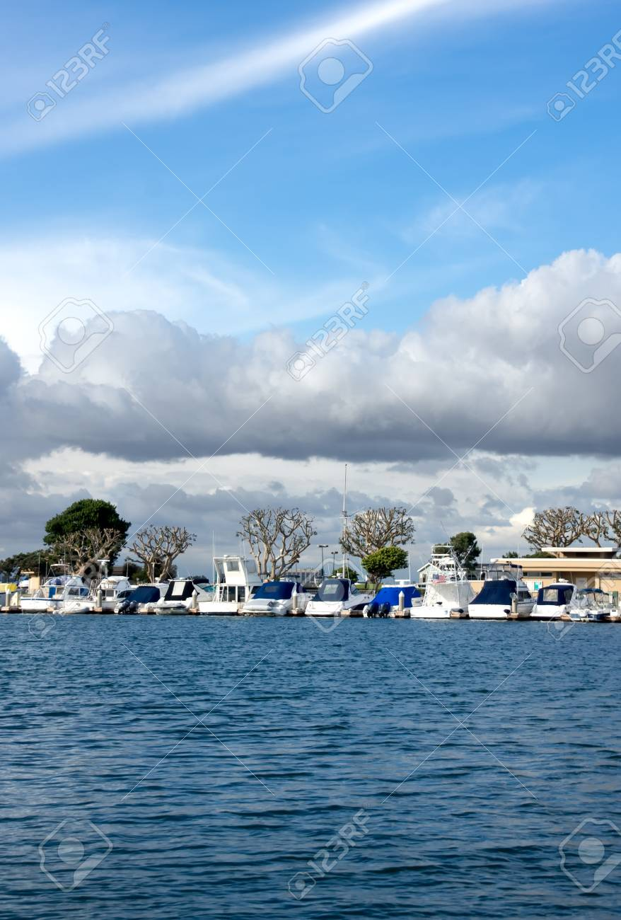Puffy clouds hover over yachts & amp, boats in Huntington Harbor Stock Photo - 13289666