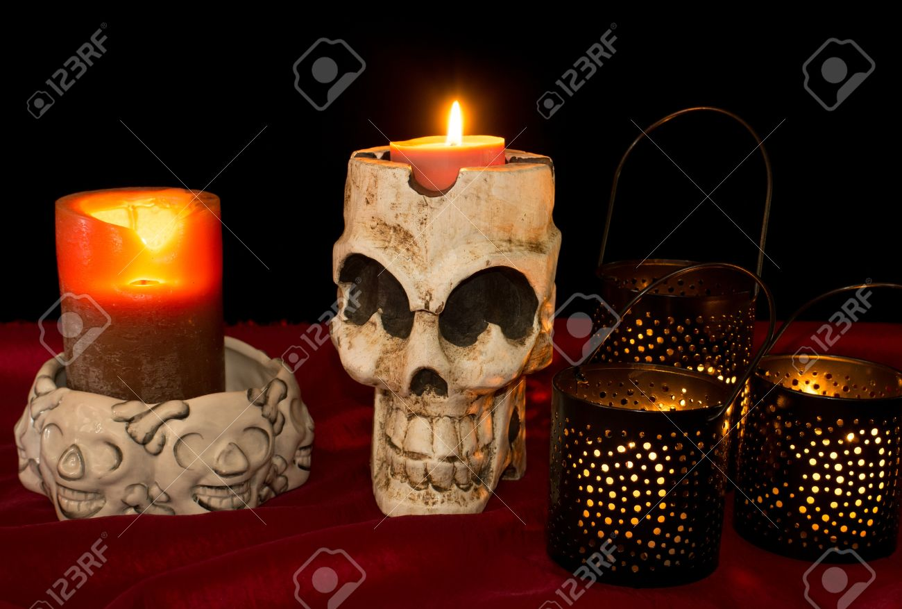 Day of The Dead  Dia de los Muertos  skull with flickering lighted candles Stock Photo - 14989292