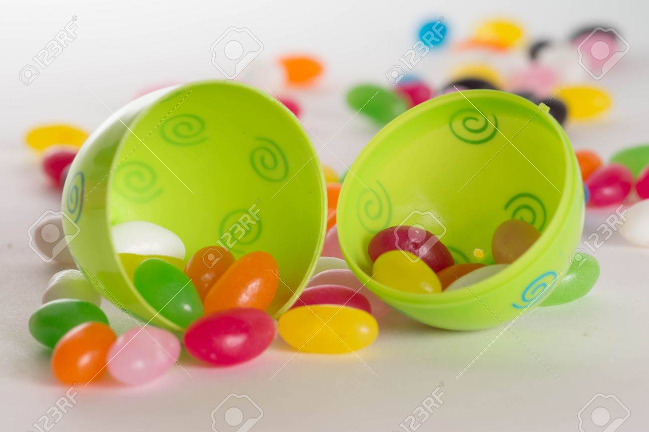 Decorated Plastic Easter Egg Open With Colorful Jelly Beans Out