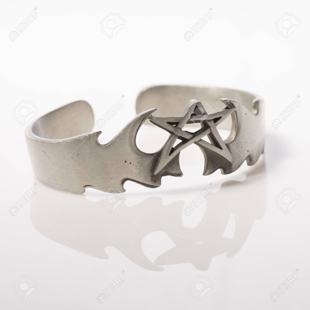 Star cuff style bracelet on white background with reflection Stock Photo - 26109948