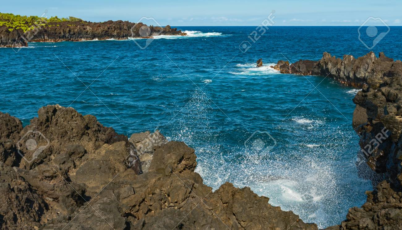 4dbd6241dc coastal view of the shore line with its black volcanic rocks and cliffs at  hana maui
