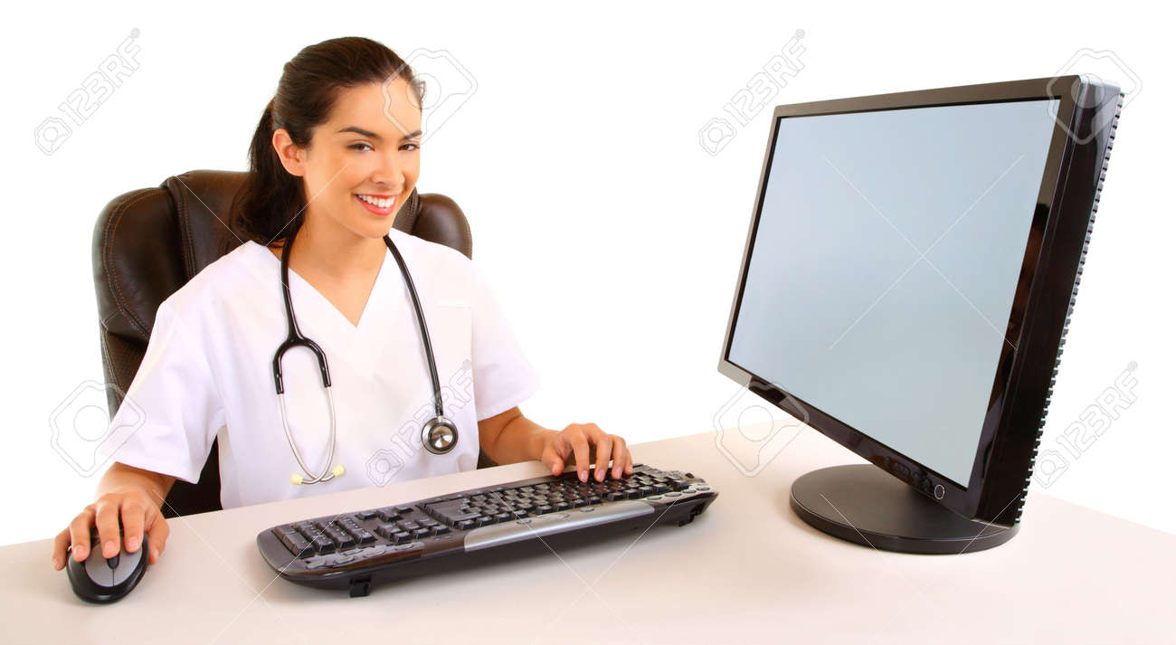 Smiling Nurse Sitting and Working at her Computer Stock Photo - 6539946
