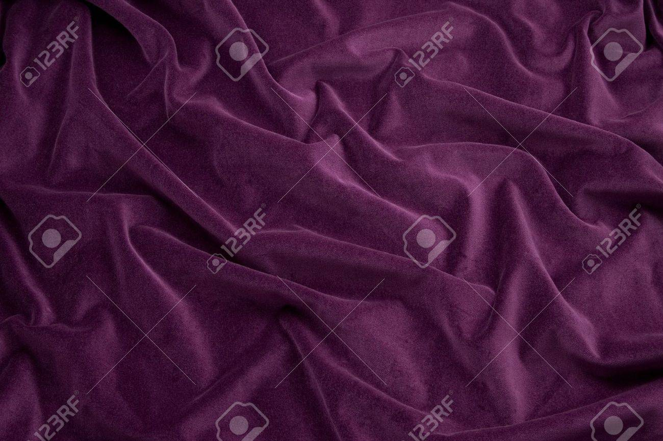 Luxurious rich purple velvet folded fabric, useful for backgrounds - 6685194