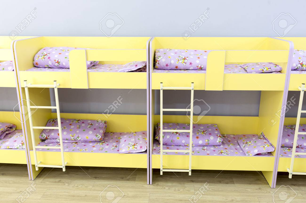 Modern Kindergarten Bedroom With Small Bunk Beds With Stairs Stock