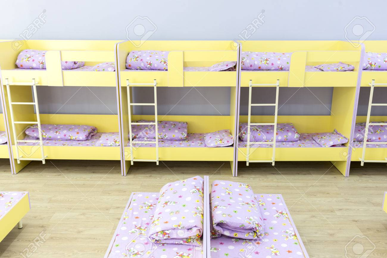 Modern Kindergarten Bedroom With Small Bunk Beds Stairs For The Kids Stock Photo