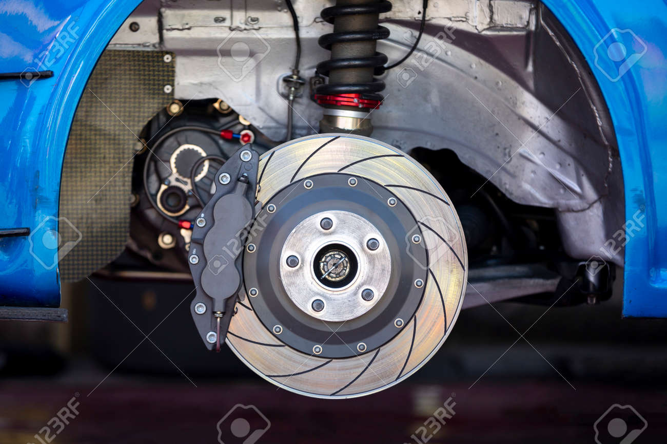 High performance brake caliper on a disc brakes with brake pads of a car. No tire. - 158229379