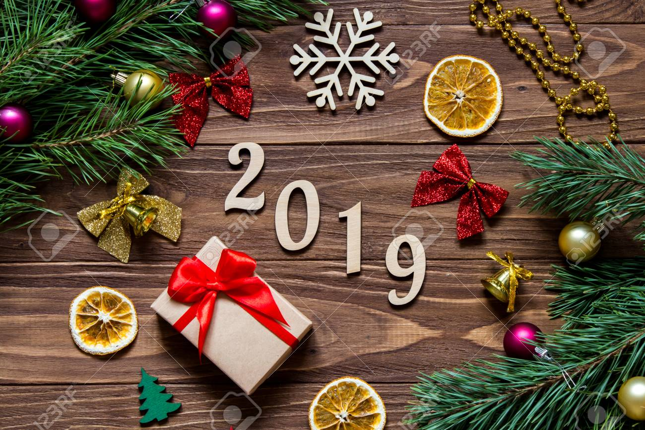 Image De Noel 2019.2019 New Year Title On The Luxurious Wooden Table Surrounded