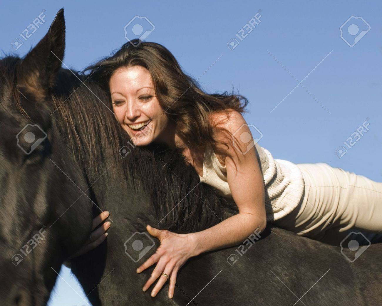 happy young woman and her best friend black stallion - 2510749