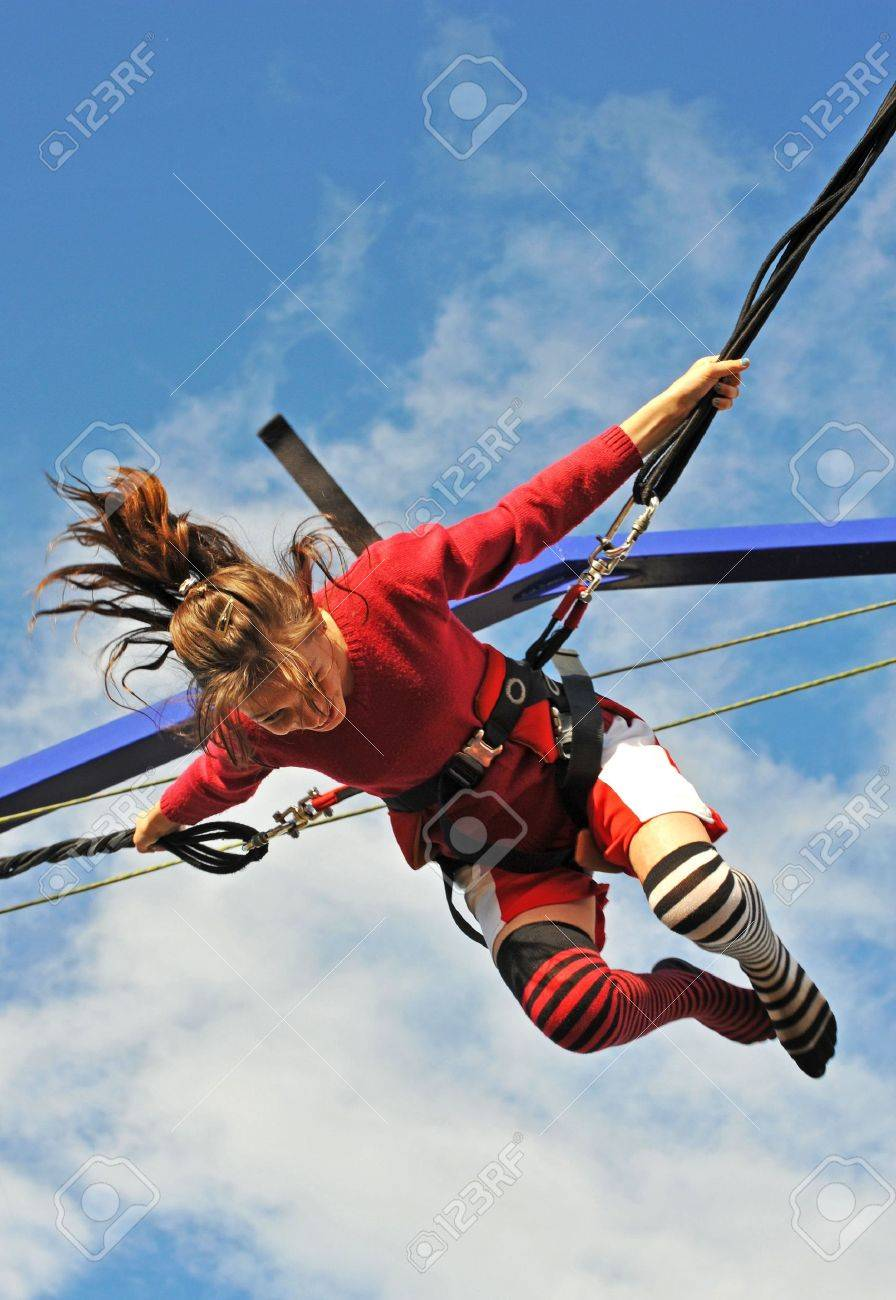 743ba3bd155a Young Teenager Jumping On The Trampoline (bungee Jumping). Stock ...