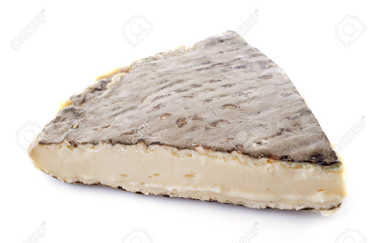 old Saint-Nectaire cheese in front of white background Stock Photo - 18119352