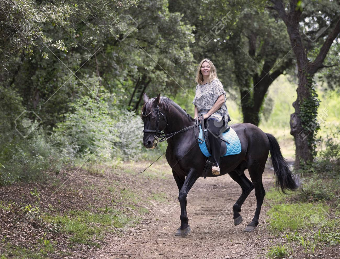 Woman Rider And Her Black Horse Are Walking In Nature Stock Photo Picture And Royalty Free Image Image 106578514
