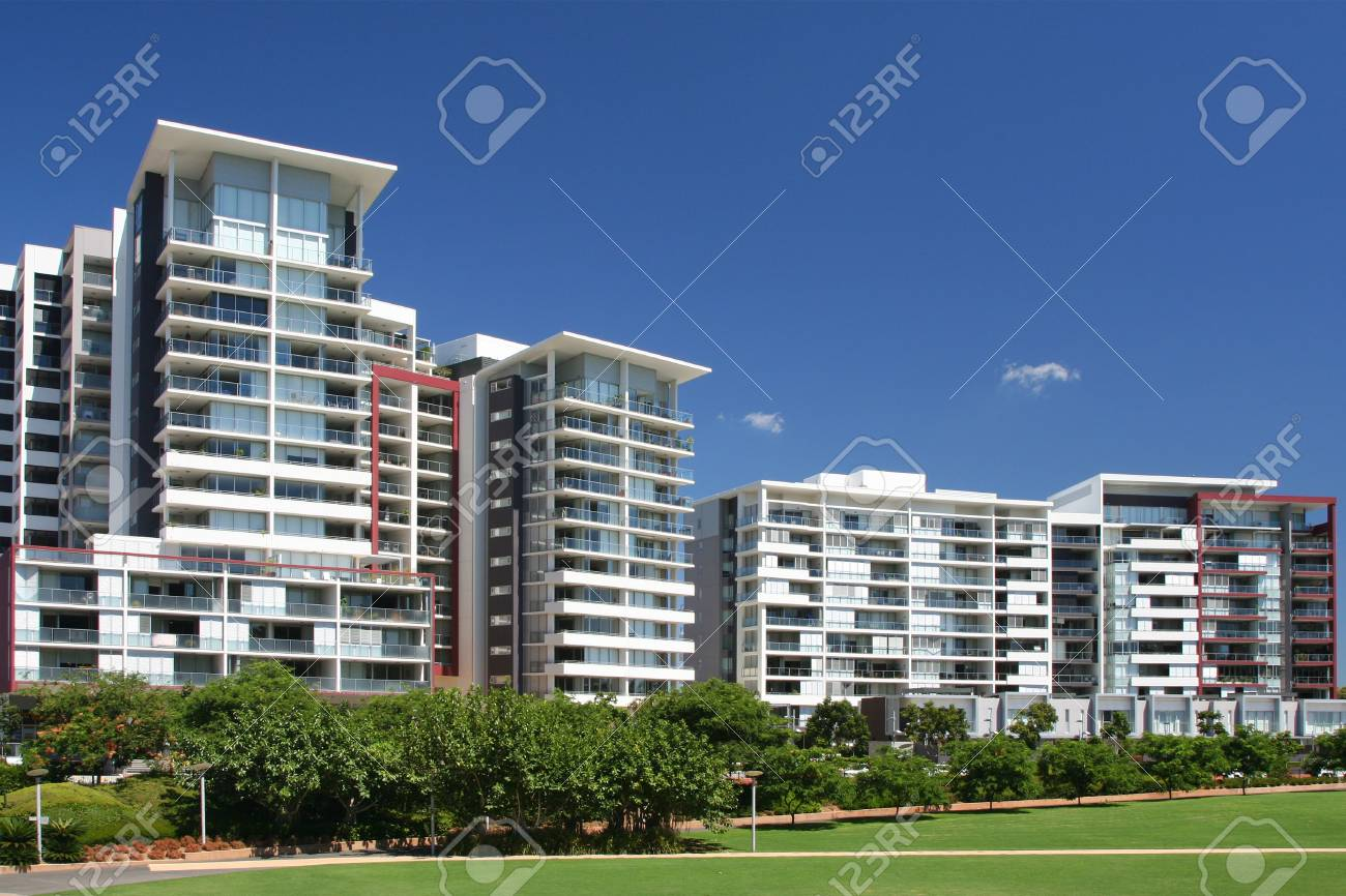 New apartments on blue background and green field Stock Photo - 4267097