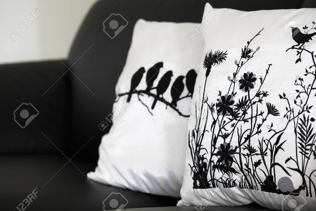 Black And White Collection Of Pillow Cases On Black Leather Couch. Generic  Designs So No