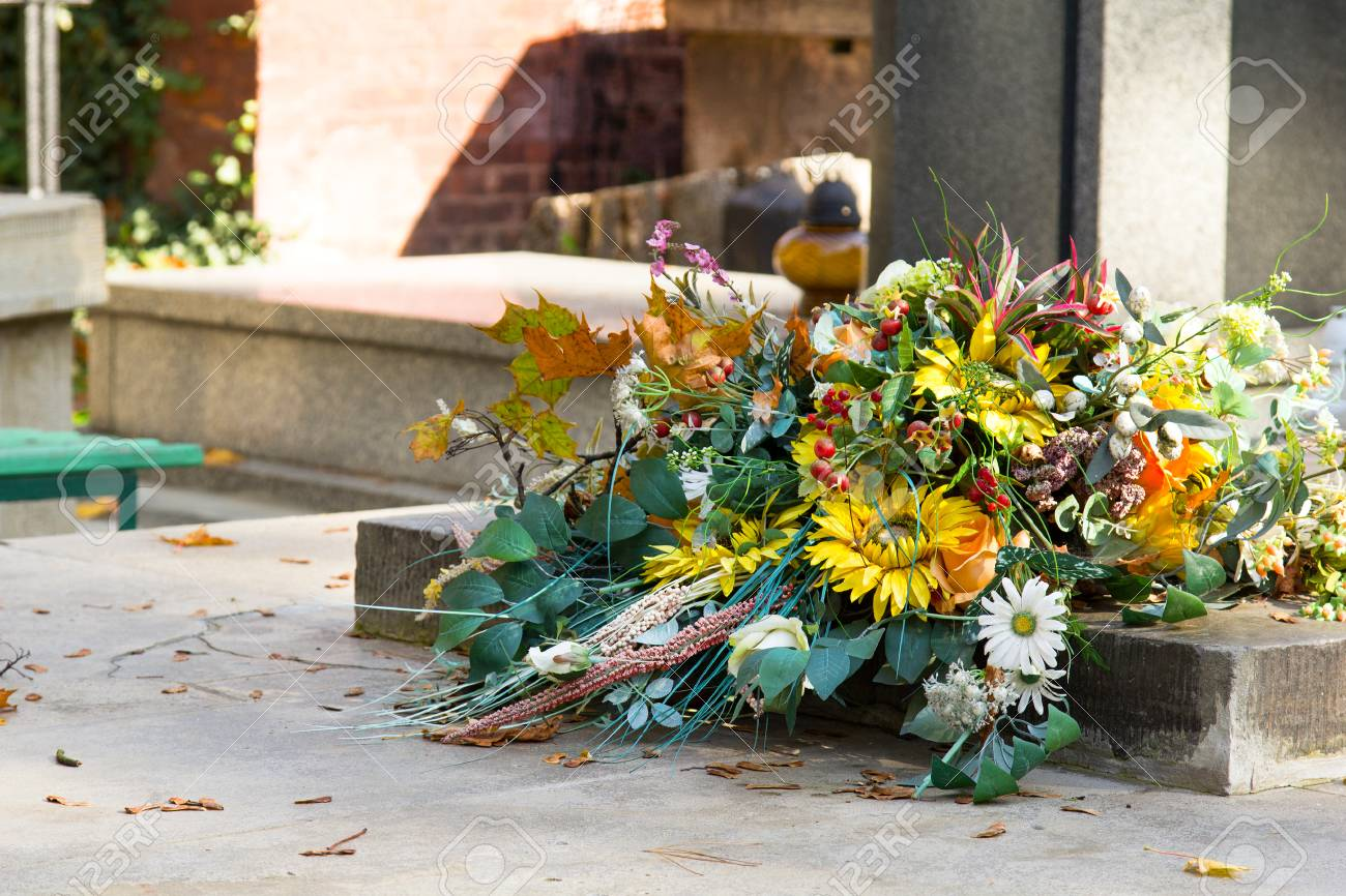 Artificial Flowers Bouquet On The Grave Cemetery Decorations Stock