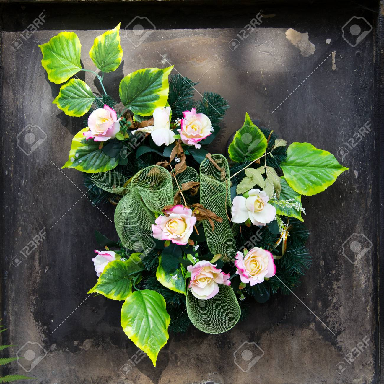 Artificial Flowers Bouquet On The Grave. Cemetery Decorations Stock ...