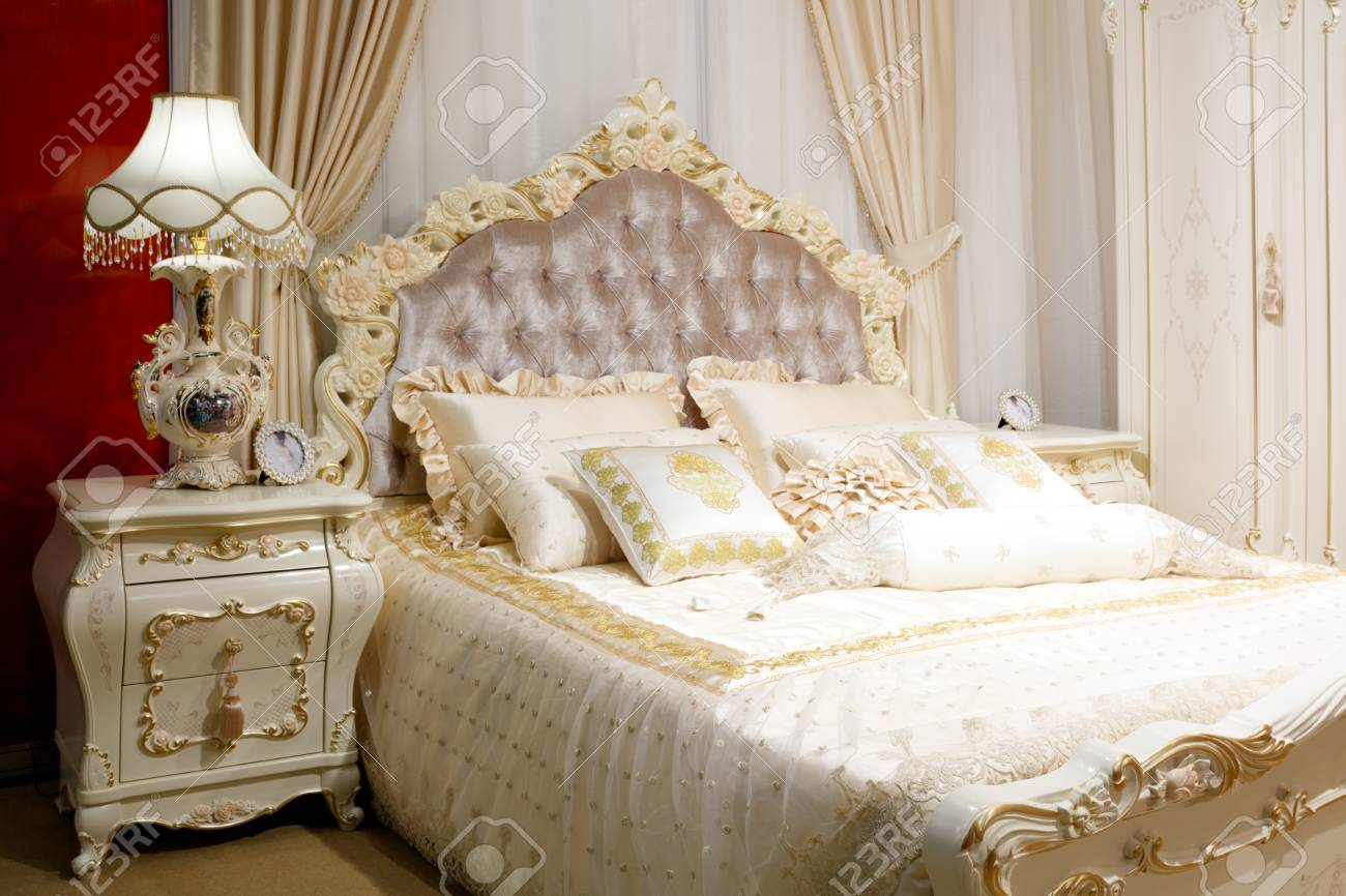 luxury modern classic style bedroom in white and pink tones,..