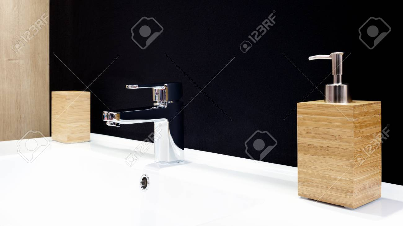 Luxury Faucet Mixer On A White Sink In A Beautiful Black Bathroom ...