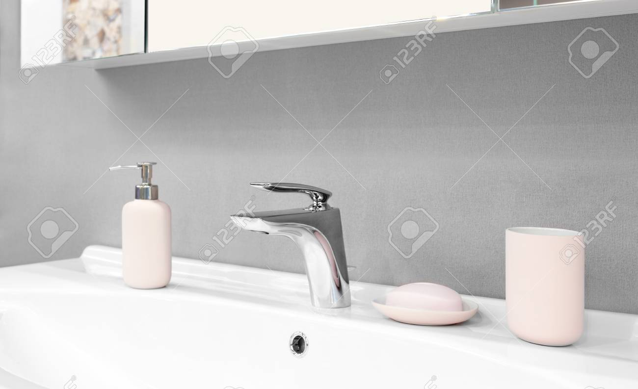 Luxury Modern Style Faucet Mixer On A White Sink In A Beautiful ...