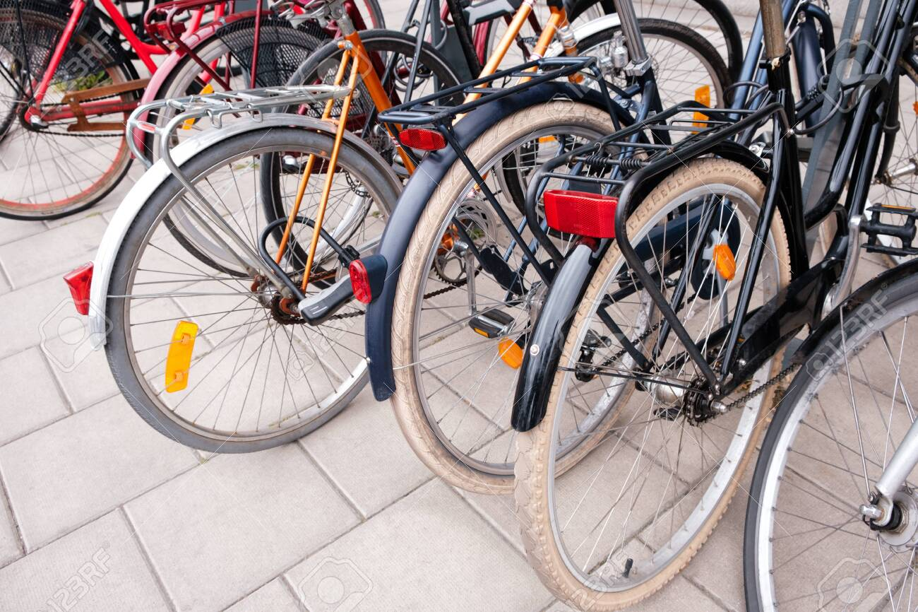 Group of bicycles parking. Sport concept with bicycle. Pile of bikes in the street of Stockholm city. Selective focus - 129033042