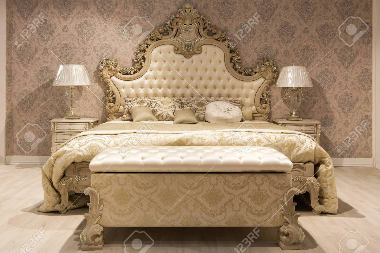Picture of: Luxurious Bedroom With Bed And Bedside Tables And A Mirror Concept Stock Photo Picture And Royalty Free Image Image 134118443