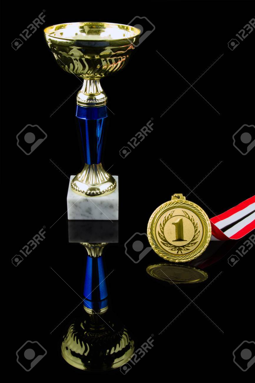 Gold Trophy And Medal Black Background Vertical Stock Photo