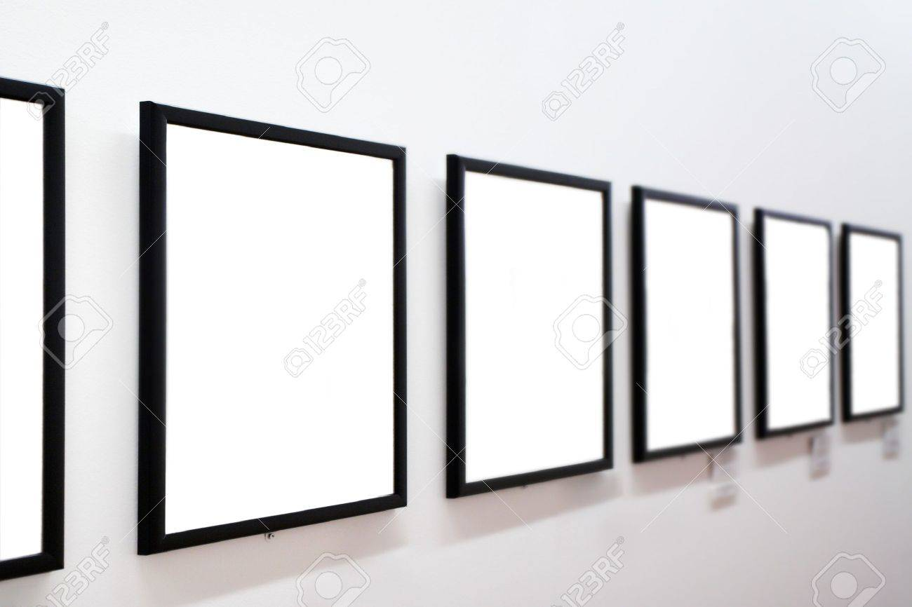 empty frames on white wall in museum stock photo