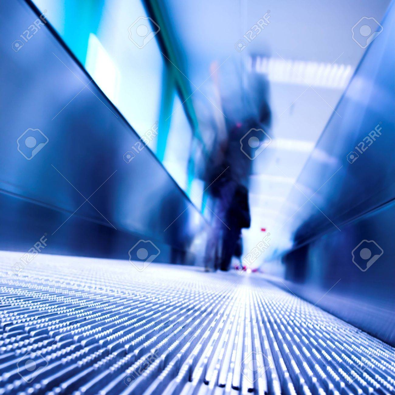 Blue moving escalator in the office hall perspective view Stock Photo - 3080121