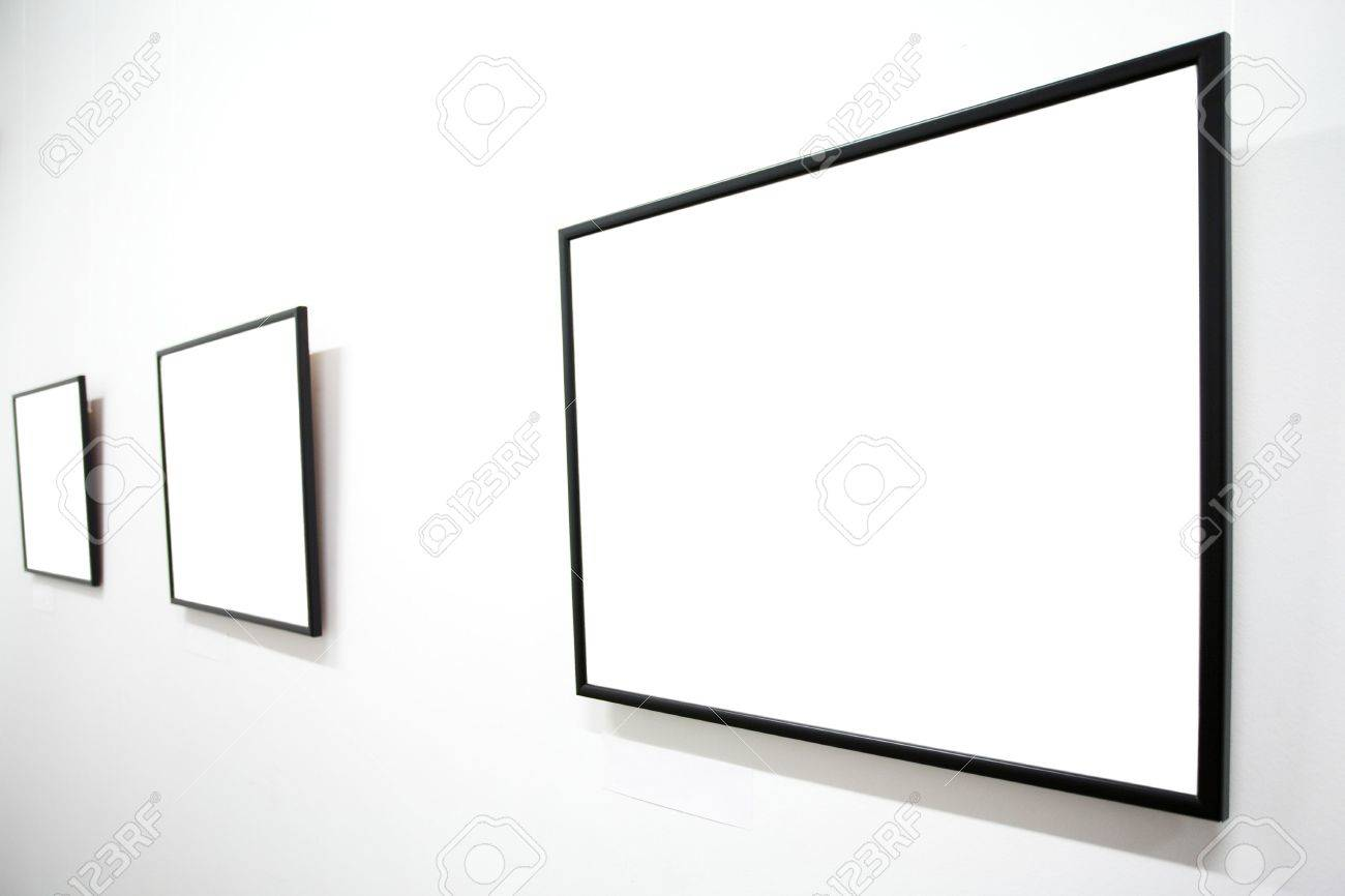 Three empty frames on white wall in museum Stock Photo - 3235977