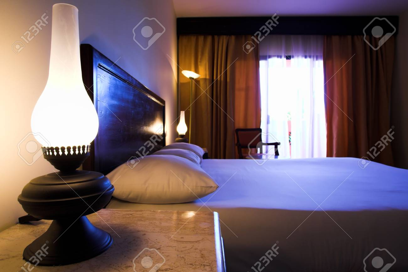 Bedroom interior with bad and lamps Stock Photo - 4188169