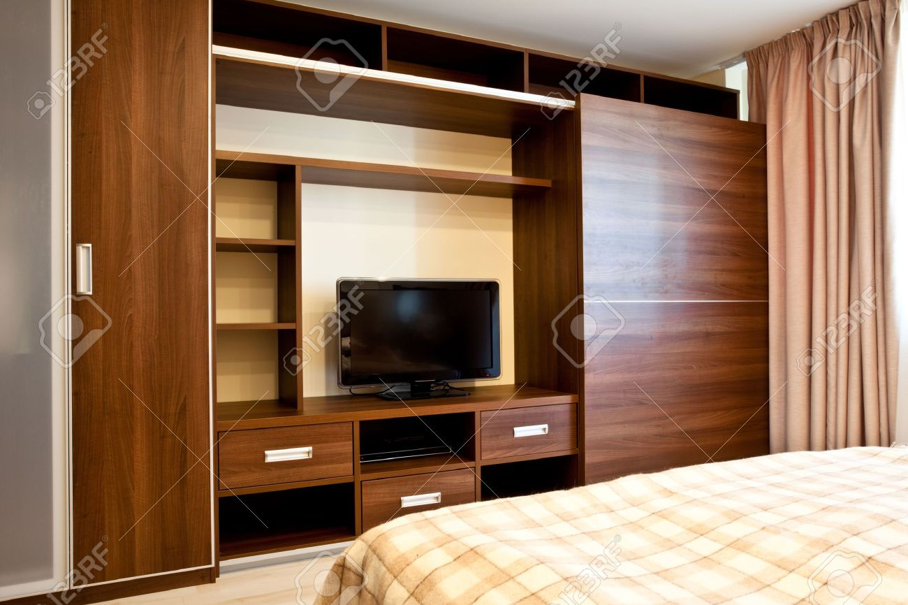 Comfortable Bedroom With TV And Wardrobes Stock Photo, Picture And ...
