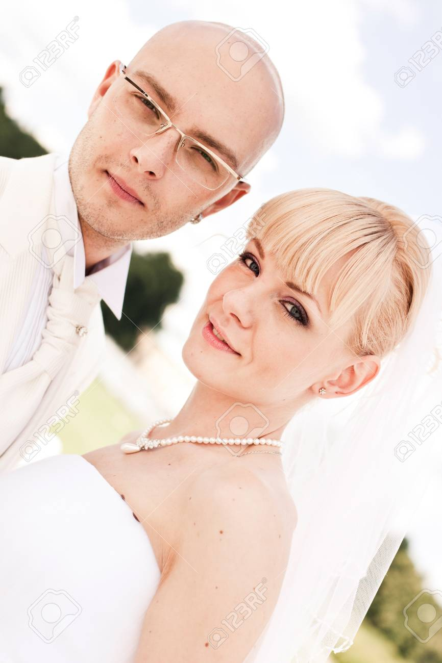 Happy young couple of bride and groom in park Stock Photo - 7521886