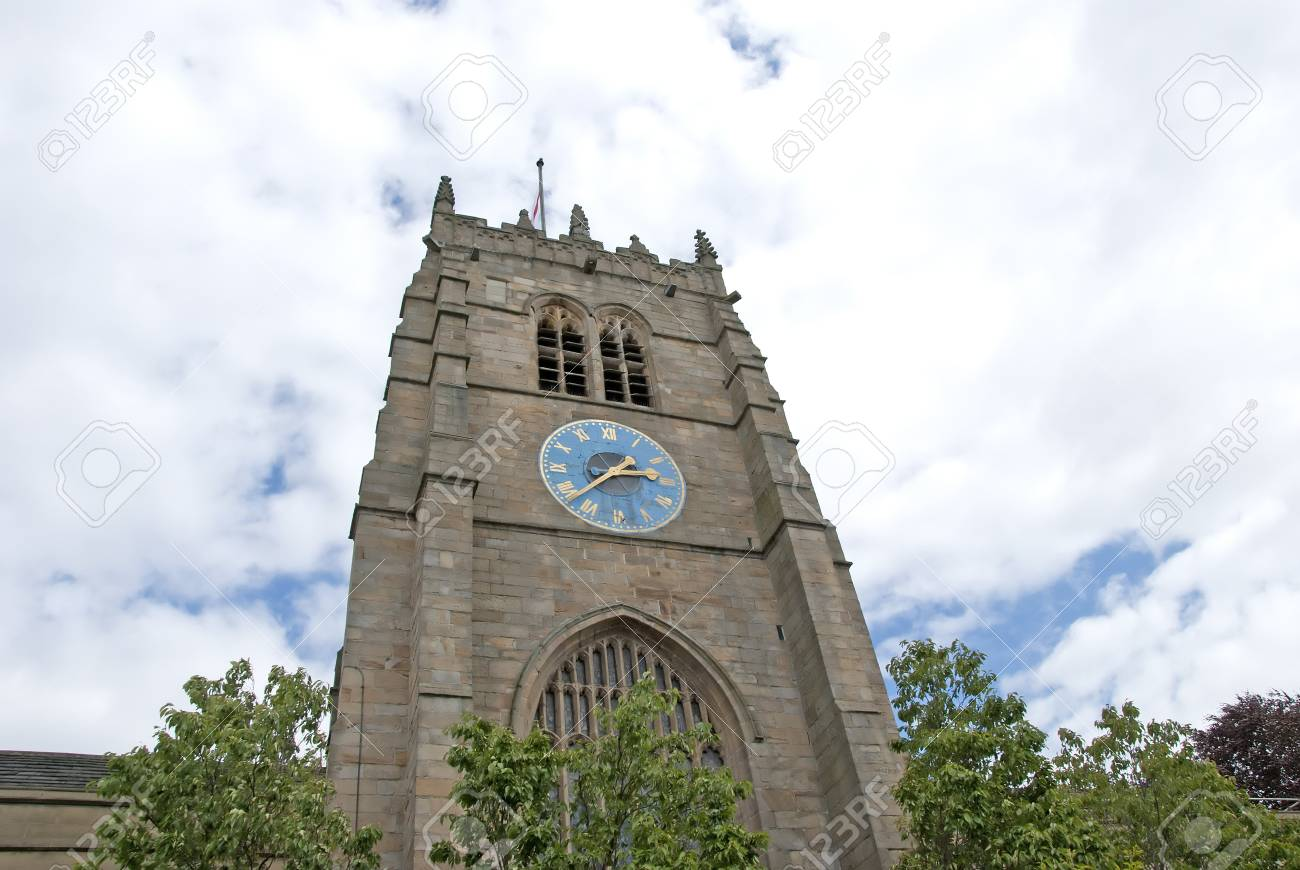 An English Cathedral Clocktower showing a blue and gold clock Stock Photo - 10301784