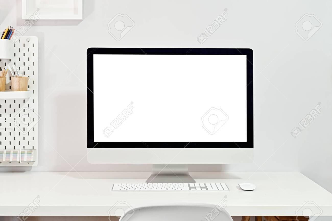 Mockup blank screen desktop computer on stylish workplace - 121268152