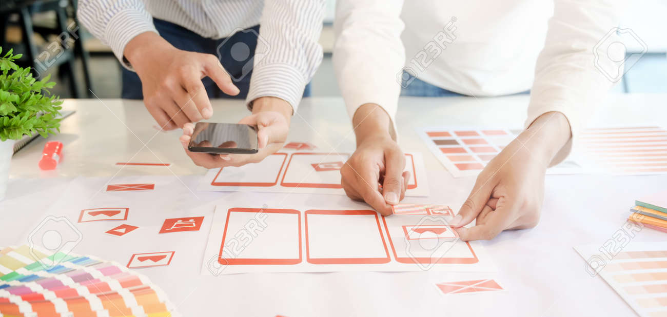 Cropped shot of young professional UX graphic designer team developing the smartphone templates in office room - 135149902