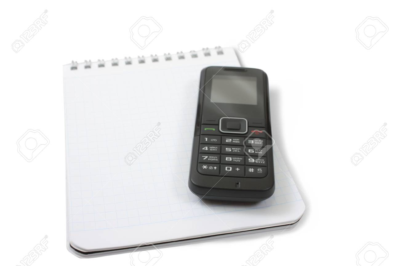 Blank notebook and mobile phone. Isolated on white. Stock Photo - 6690750