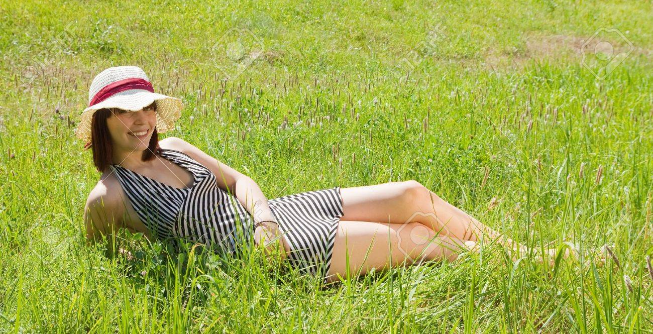 short-haired teen girl lying in meadow grass Stock Photo - 7481979
