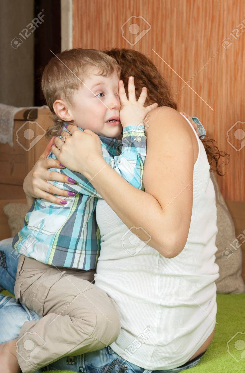 crying child and his careful mom in home interior Stock Photo - 10830985