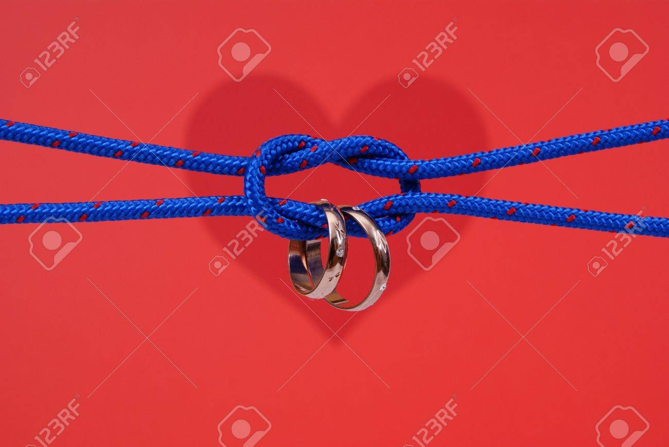 Connected Strings With Golden Wedding Rings On Red Background Stock Photo 4509399: Red String Wedding Rings At Reisefeber.org