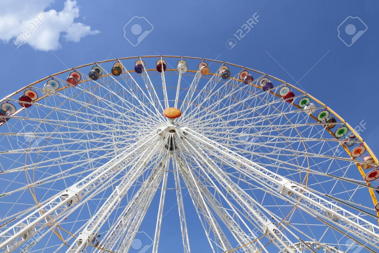 Ferris wheel in an amusement park against blue sky Stock Photo - 7402354